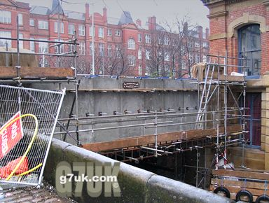 The 130-year-old cast-iron bridge on Canal Street has been replaced by a concrete one