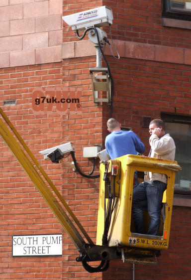 Workmen with a CCTV camera in Manchester