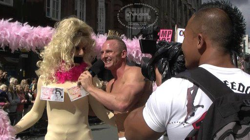 Chris Geary attempts to interview Wynnie LaFreak at the Manchester Pride parade in 2011