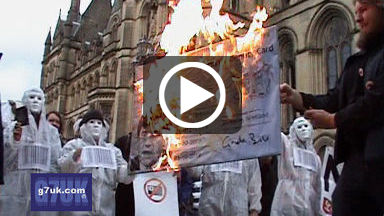 NO2ID campaigners burn a giant ID card in front of Manchester town hall
